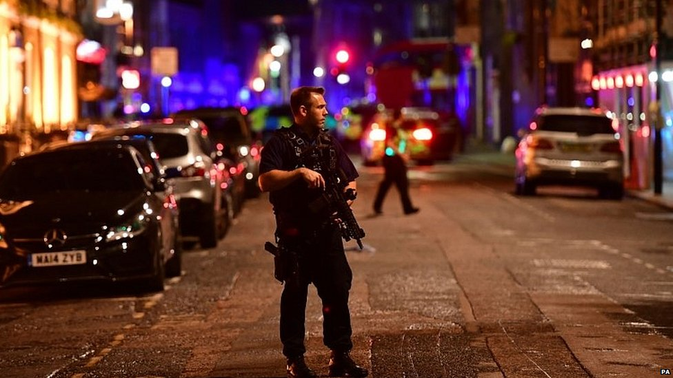 Armed police officer in central London