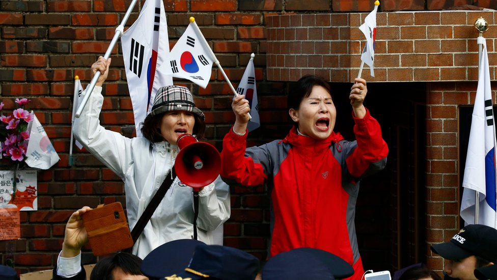 Supporters of impeached South Korean former President Park Geun-hye, gather around her home