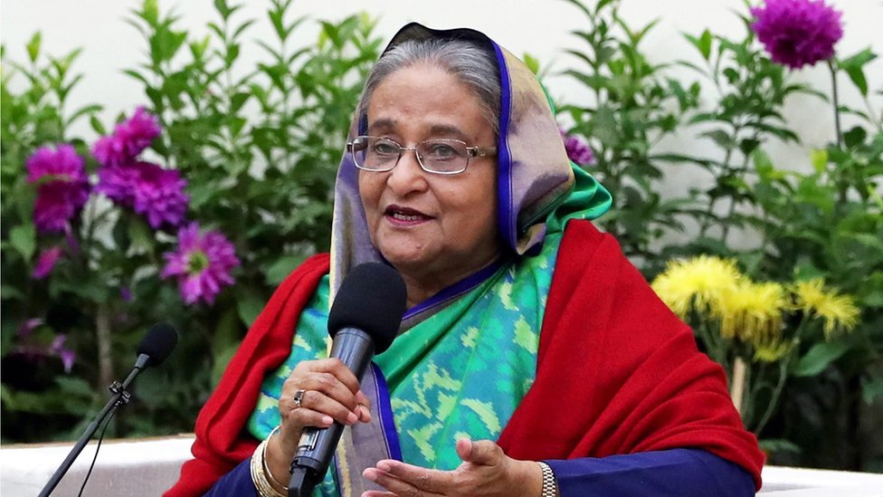 Bangladesh Prime Minister Sheikh Hasina speaks with foreign election observers and journalists at the Gono Bhaban in Dhaka