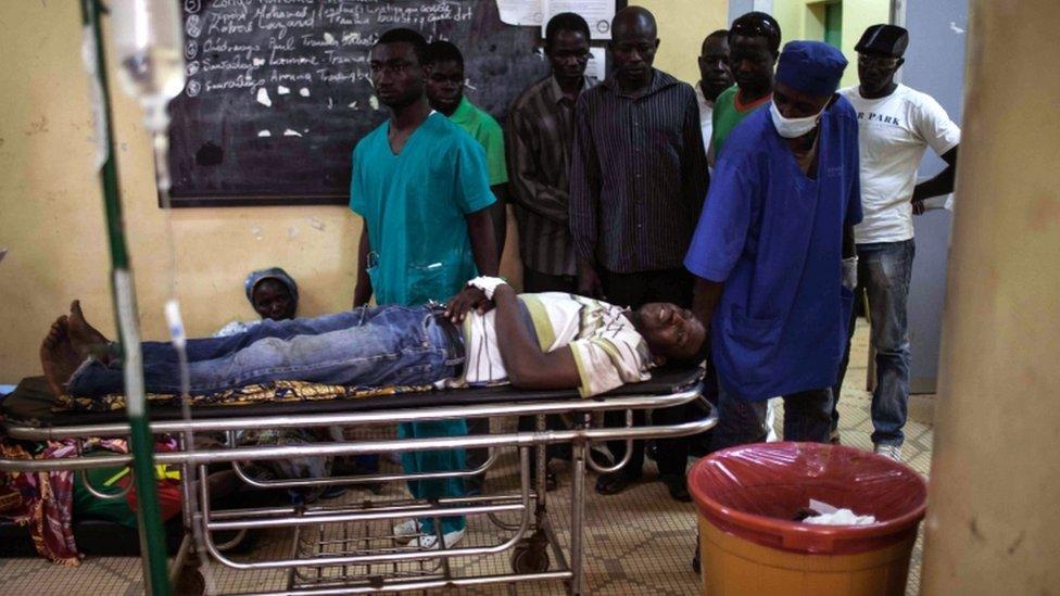 An injured protester on a stretcher in a hospital in Ouagadougou, Burkina Faso, 17 September 2015