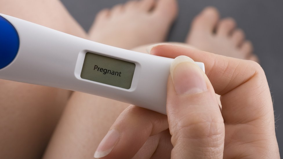 pregnancy test showing woman is pregnant