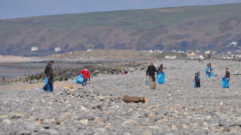 Several beach cleaners on Borth beach