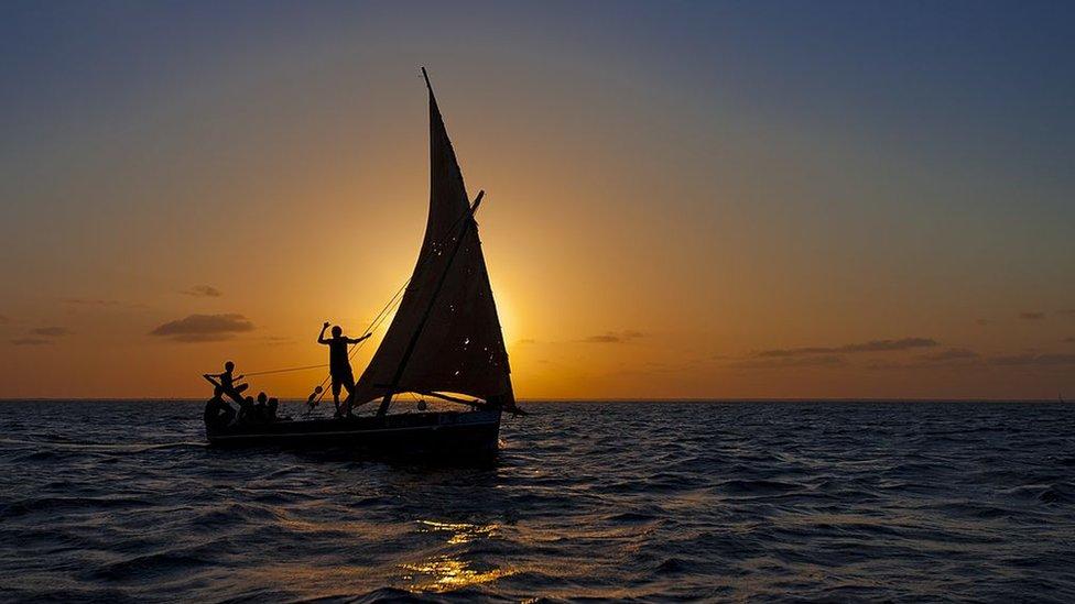 Dhow boat at sunrise off Lamu in Kenya.