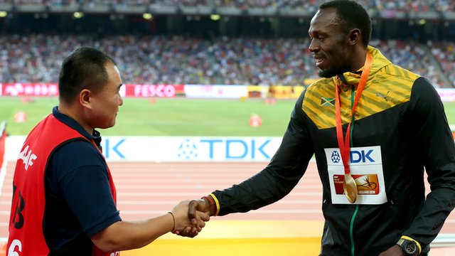 Usain Bolt meets the cameraman who sent him tumbling.