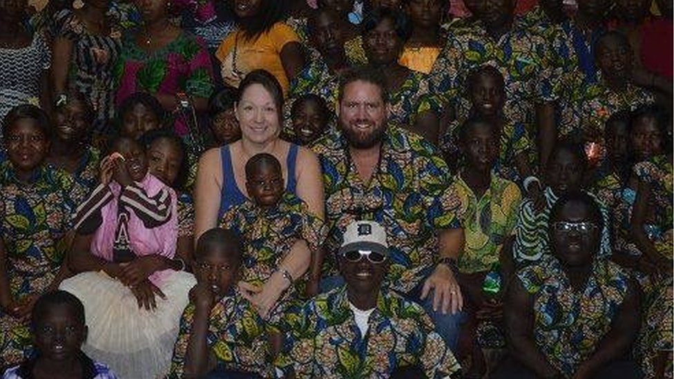 Image showing American missionary Mike Riddering with his sister and a group of children in Africa - January 2016