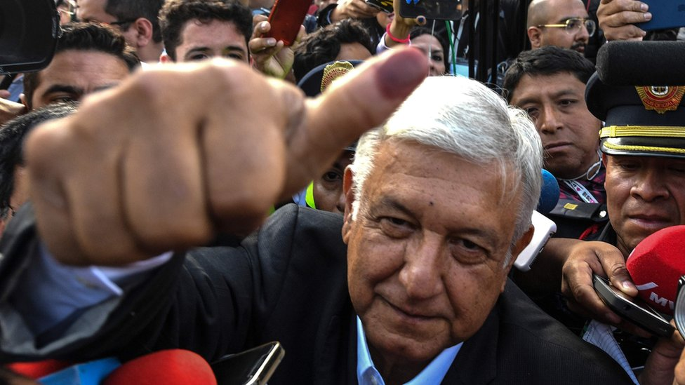 "Mexico's presidential candidate Andres Manuel Lopez Obrador for the ""Juntos haremos historia"" party, gives his thumb up while leaving the polling station during general elections, in Mexico City, on July 1, 2018."