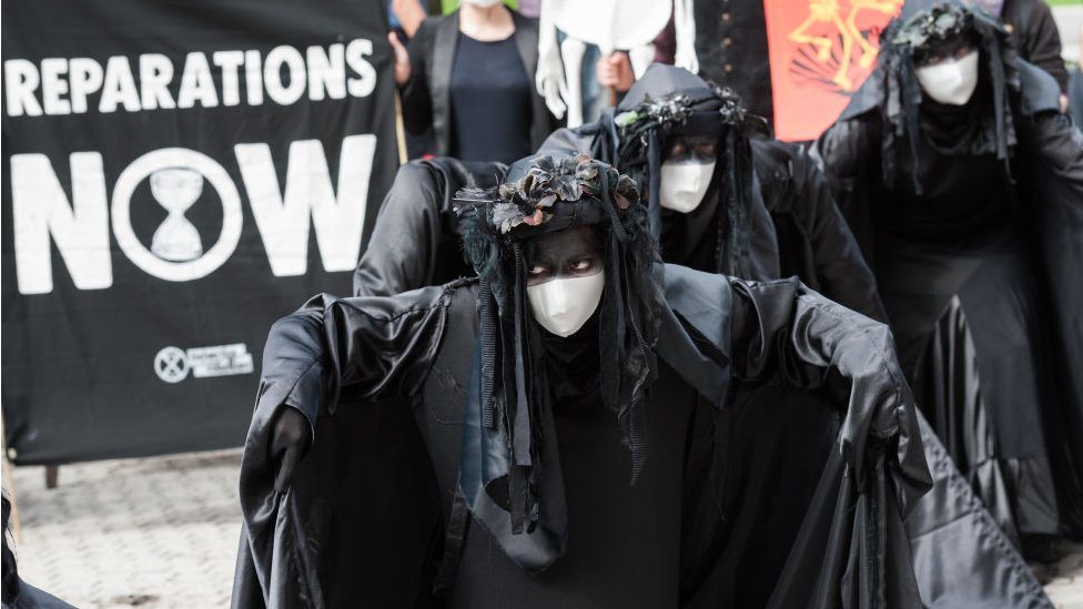 Extinction Rebellion's Black Brigade join a protest outside corporate offices of oil company Shell demanding an end to extraction of fossil fuels and reparations for the communities affected by environmental pollution caused by oil spills in the Niger Delta, on 08 September, 2020 in London, England.