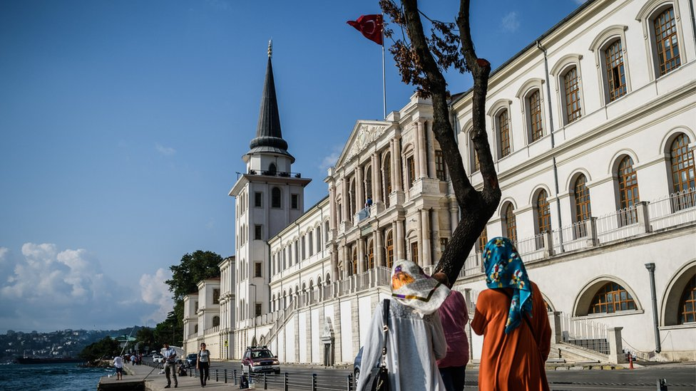 Hijab-clad women walk along the shores of the Bosphorus, Istanbul (file photo 4 August)