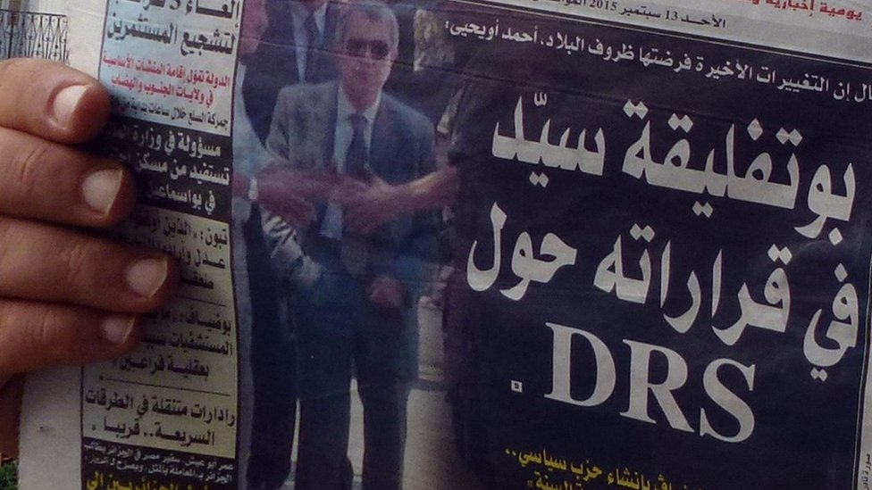 A newspaper photo of Mohamed Mediene