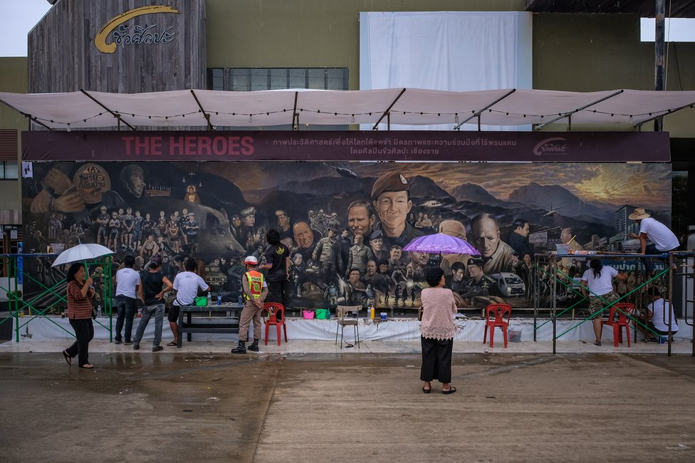 Artists work on an art mural at Art Bridge gallery in Chiang Rai, Thailand