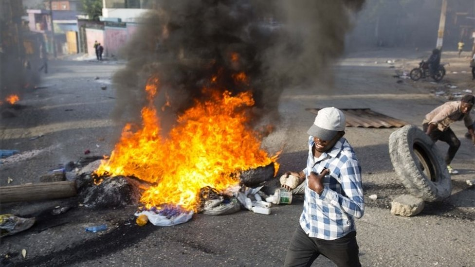 People protest over the cost of fuel in Port-au-Prince, Haiti, Friday, July 6, 2018.