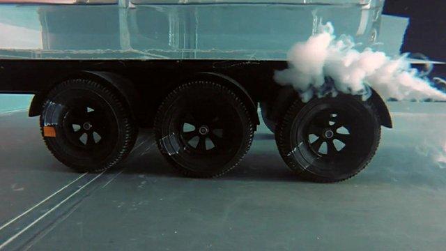 model of lorry under test in water tank