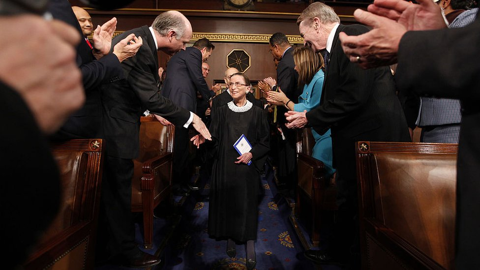 Associate Supreme Court Justice Ruth Bader Ginsburg (C) arrives for U.S. President Barack Obama's address to a joint session of Congress in the House Chamber of the US Capitol 24 February, 2009 in Washington, DC