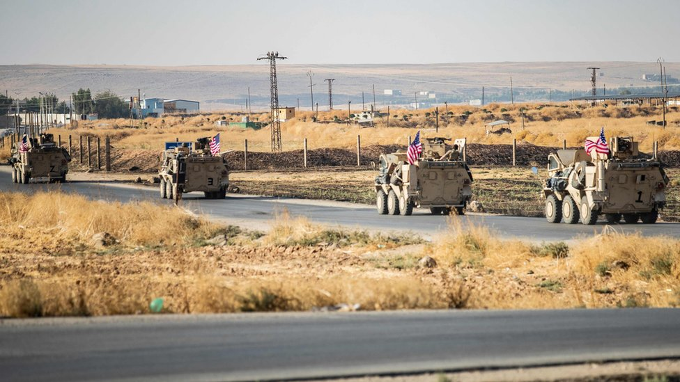US military vehicles patrol near the Syrian town of Tal Baydar on 12 October 2019