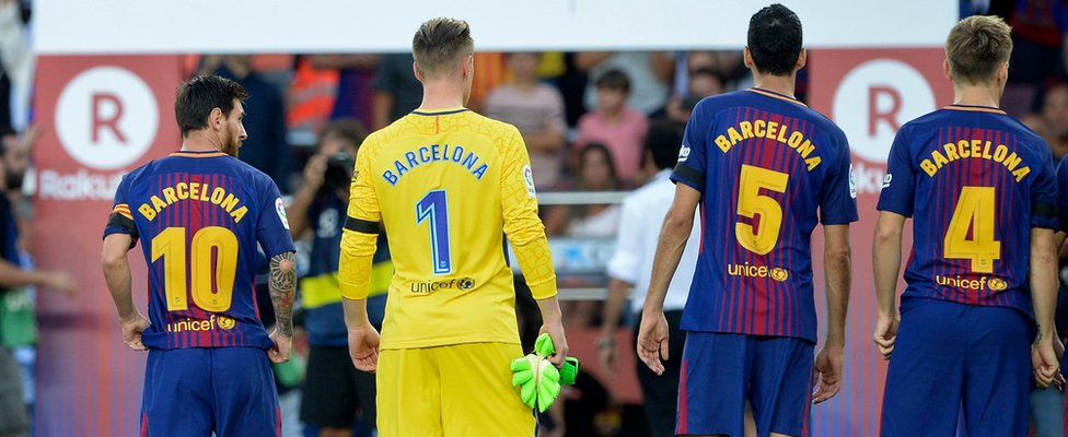 """Barcelona's Argentinian forward Lionel Messi, German goalkeeper Marc-Andre Ter Stegen and teammates stand with their jerseys reading """"Barcelona"""""""