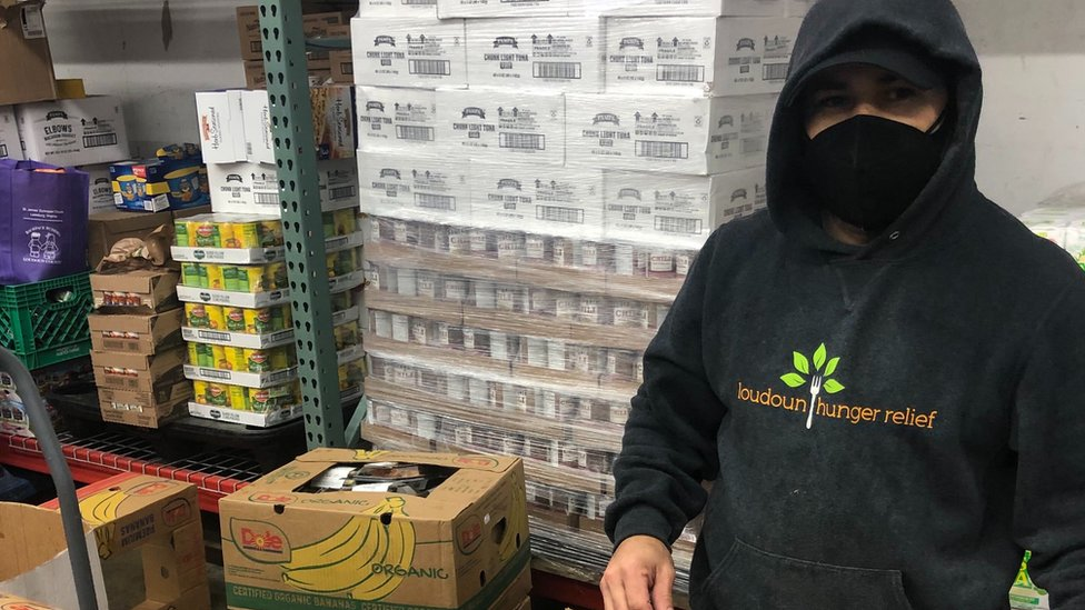 A volunteer helps with Loudoun Hunger Relief