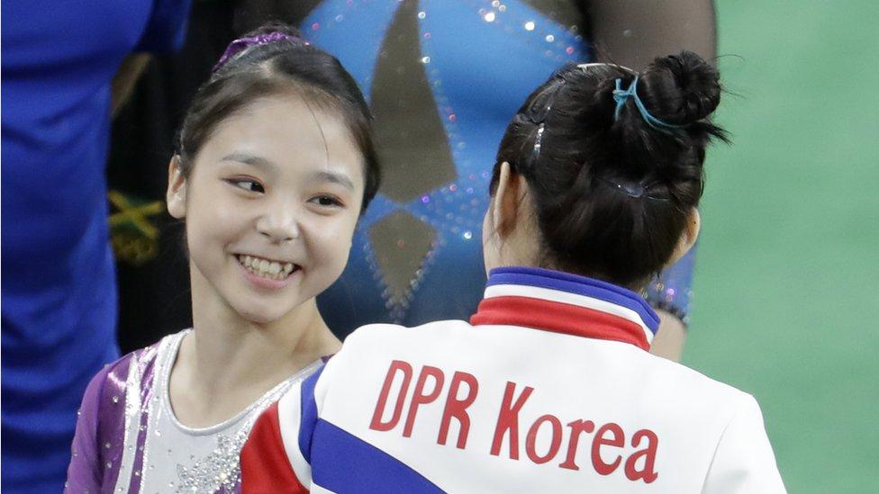 "South Korea""s Lee Eun-ju, left, talks with North Korea""s Hong Un Jong during the artistic gymnastics women""s qualification the 2016 Summer Olympics in Rio de Janeiro, Brazil, Sunday, Aug. 7, 2016."