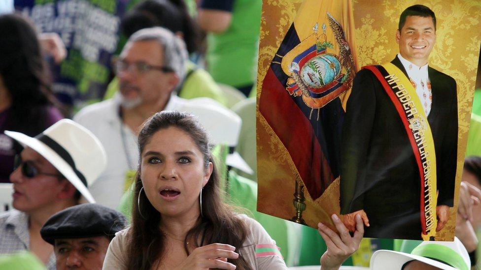 A supporter of Ecuador's former President Rafael Correa holds a poster during a convention of the Alianza Pais party in Esmeraldas, Ecuador, on 3 December 2017
