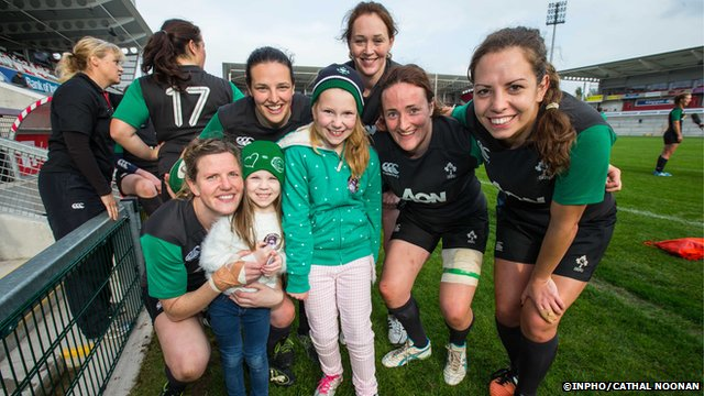 Ireland women's rugby union team with young fans