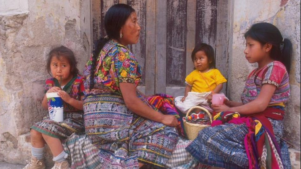 A family of women wearing brightly coloured clothes