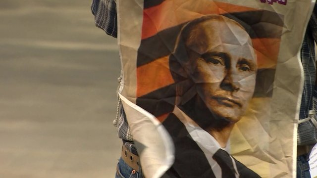 Image of Putin worn at a protest