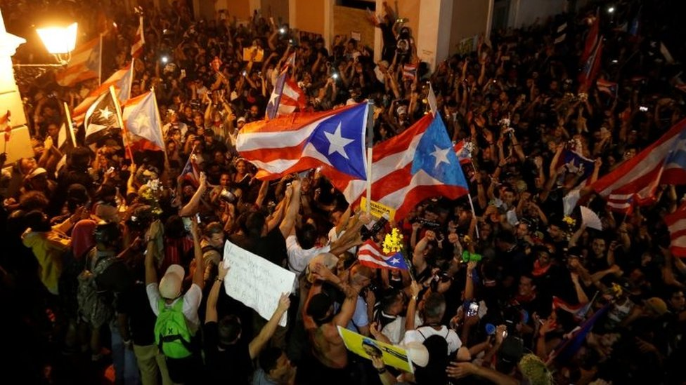 People celebrate in San Juan after the news that Governor Ricardo Rosselló is to resign. Photo: 24 July 2019