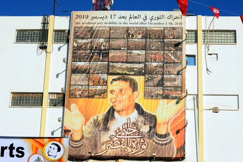 A giant portrait of Tunisian protester Mohamed Bouazizi
