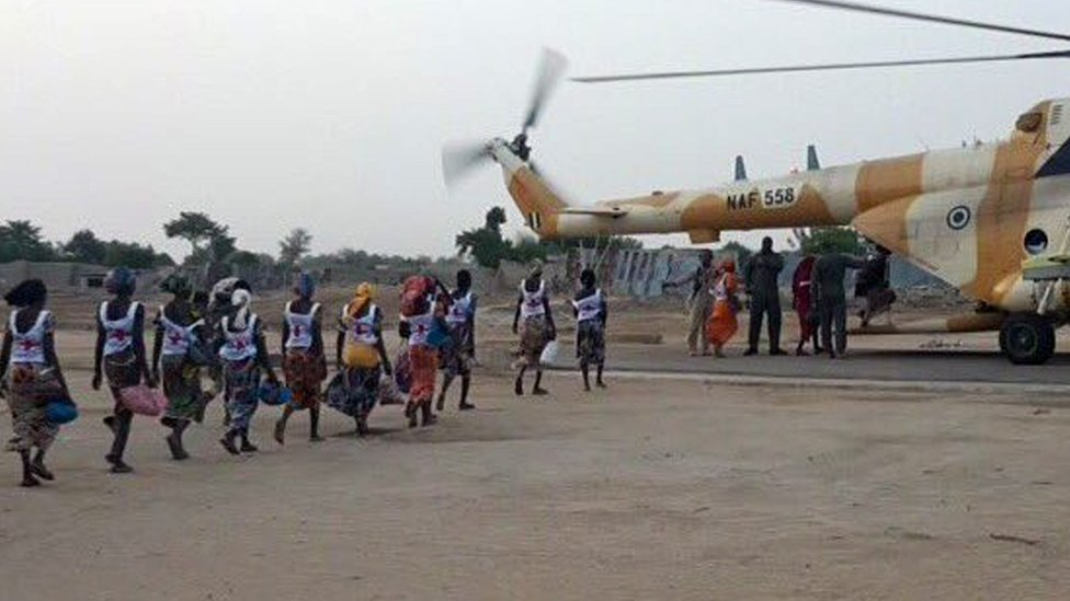 Some of the 82 released Chibok girls board an aircraft