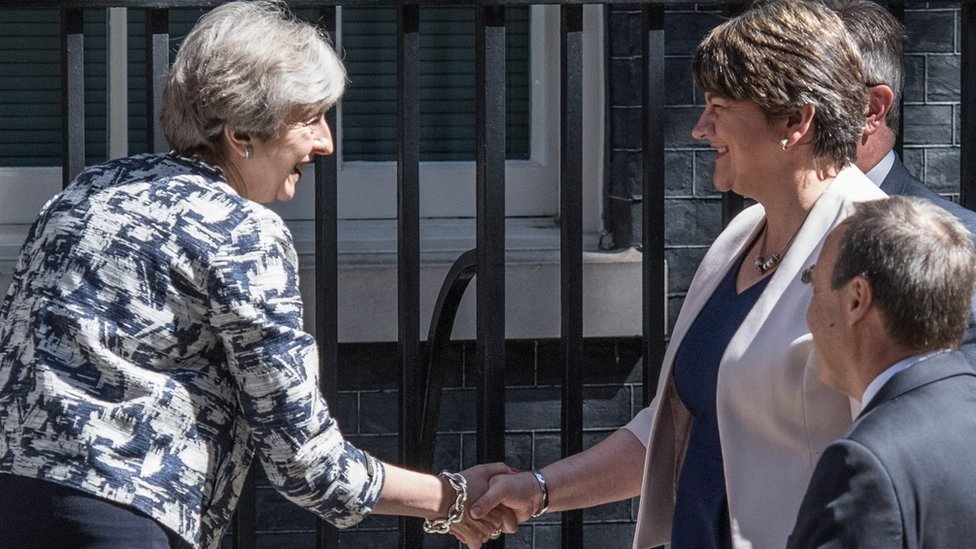 UK PM Theresa May and DUP leader Arlene Foster shake hands outside Downing Street on 26 June 2017