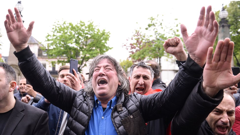 Supporters of Ramush Haradinaj outside the court in Colmar on 27 April