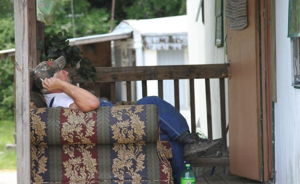 Man outside his trailer home in Jamestown