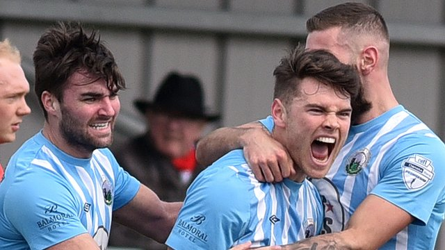 Warrenpoint players celebrate a vital victory over Portadown