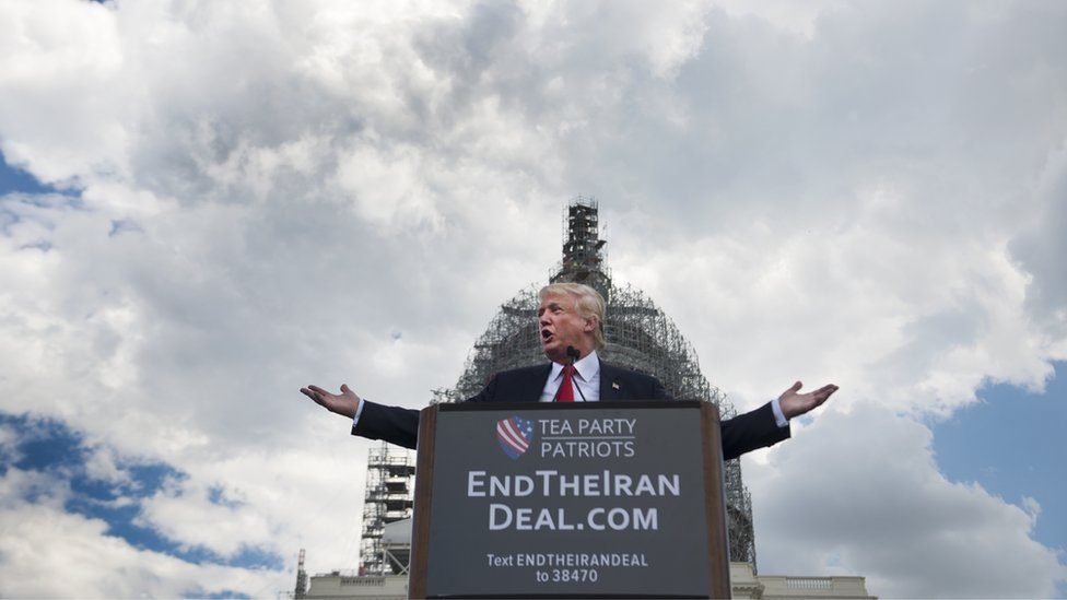 Trump speaks outside Capitol in front of a sign saying 'EndTheIranDeal.com'