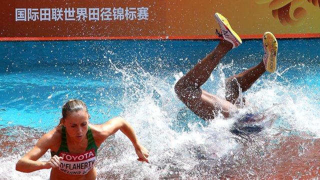 Panama runner Rolanda Bell disappears underwater in the 3000m steeplechase