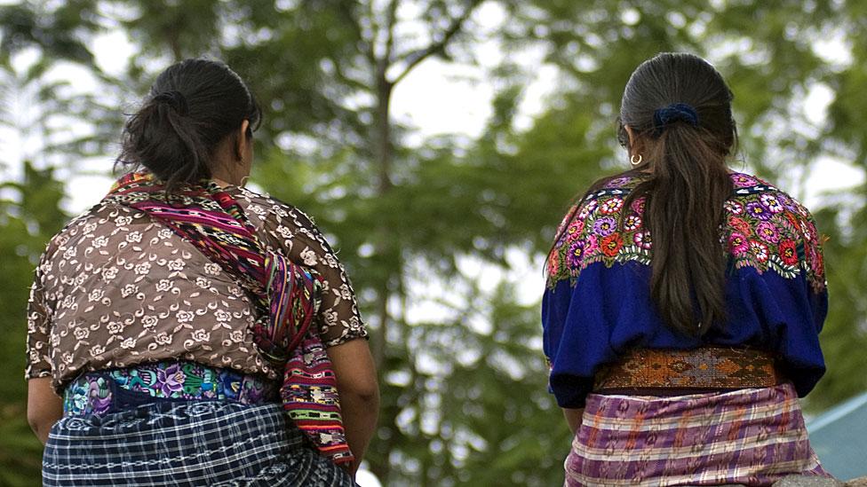 Guatemalan women sitting on a wall
