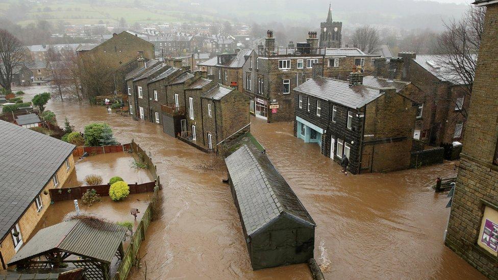 The River Calder bursts its banks in the Calder Valley town of Mytholmroyd on 26 December 2015