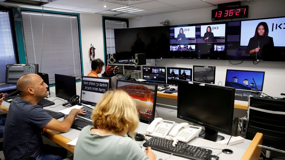 Employees work in the offices of Kan, the new Israeli public broadcasting corporation, in Tel Aviv (3 November 2016)