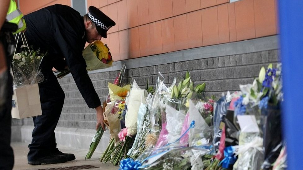 Police officer laying flowers