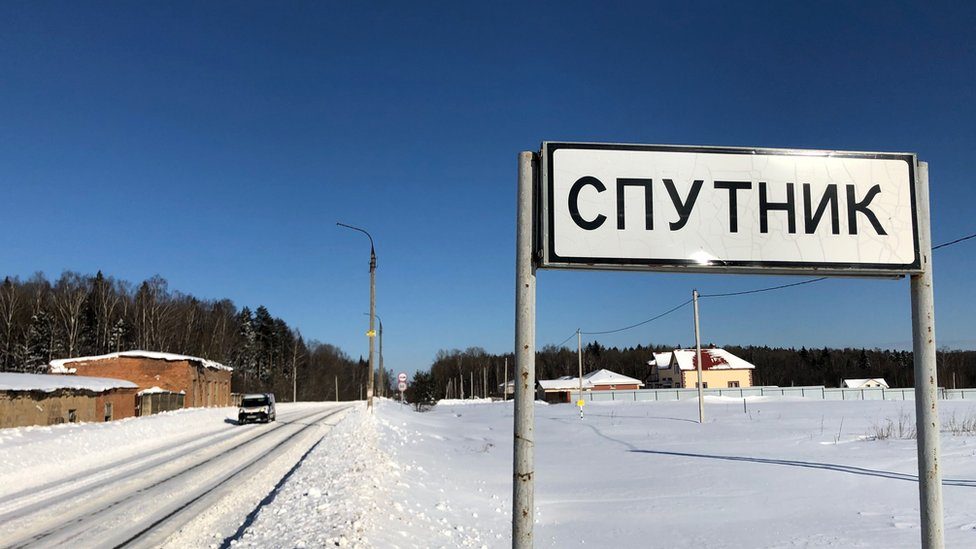 A sign in Russian at the entrance to Sputnik village