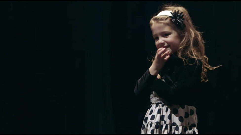 A Sandy Hook student taking part in the play