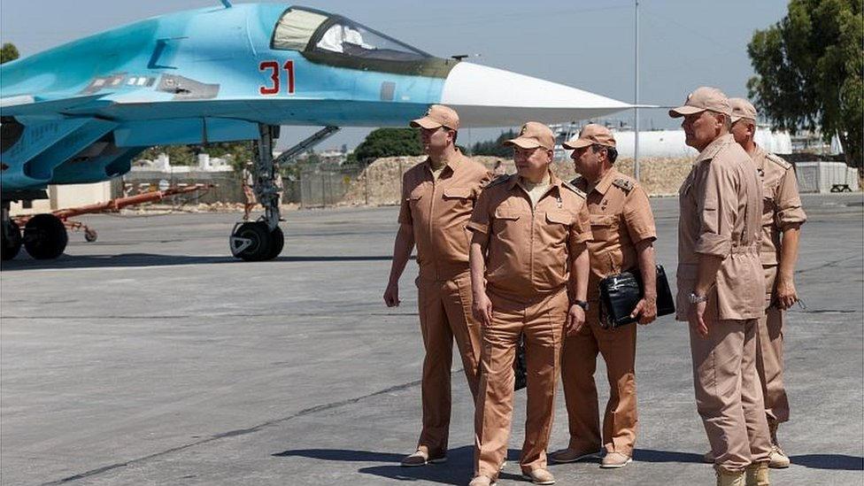 Russian Defense Minister Sergei Shoigu (second left) at the Hemeimeem air base in Syria (July 2016)