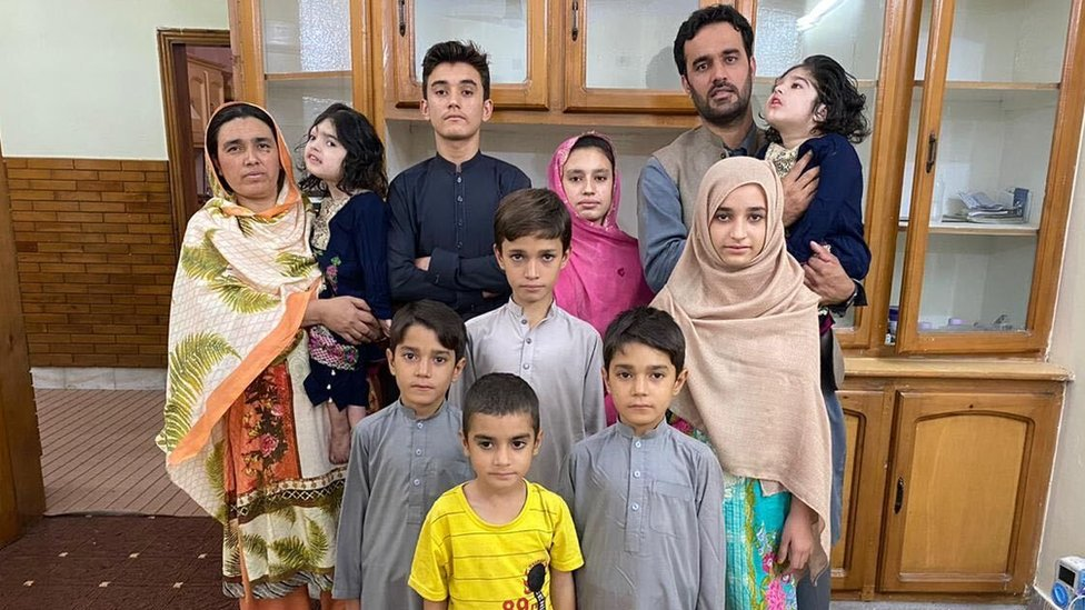 Safa and Marwa with their family in Pakistan
