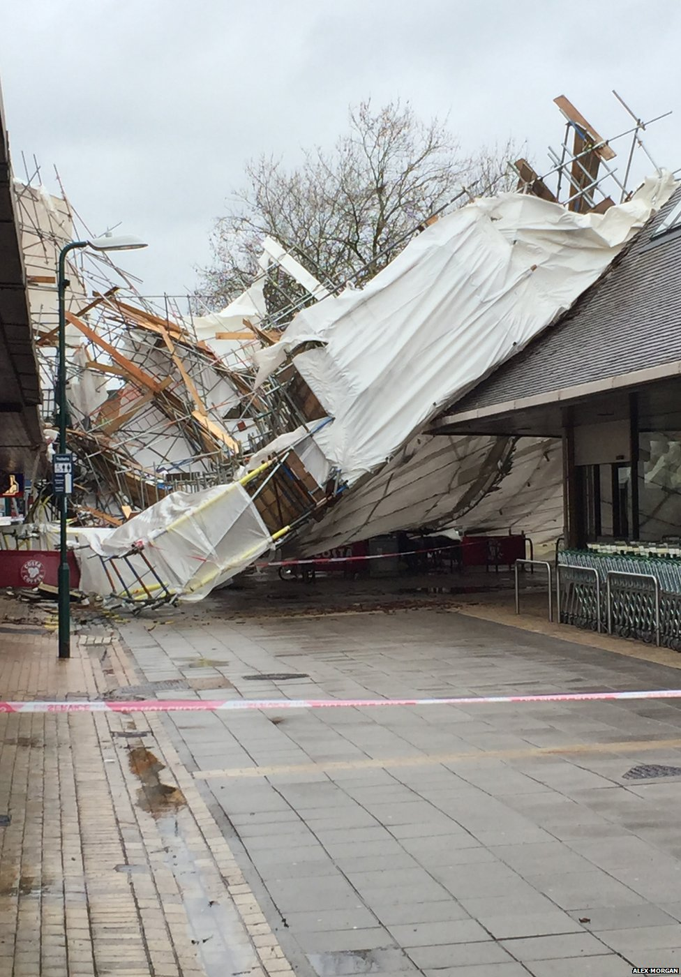 """The main shopping street in Woodley, Reading. Alex Morgan says: """"The scaffolding from the building on the left has been ripped off and now covers the high street"""". Credit: Alex Morgan"""