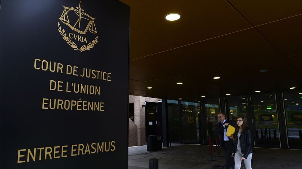 People walk away from the entrance of the European Court of Justice (SCJ) in Luxembourg
