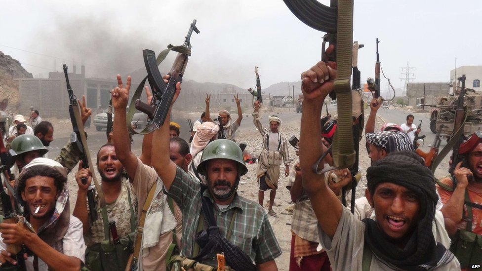 Yemeni pro-government forces raise their weapons at the Al-Anad airbase on 5 August, 2015