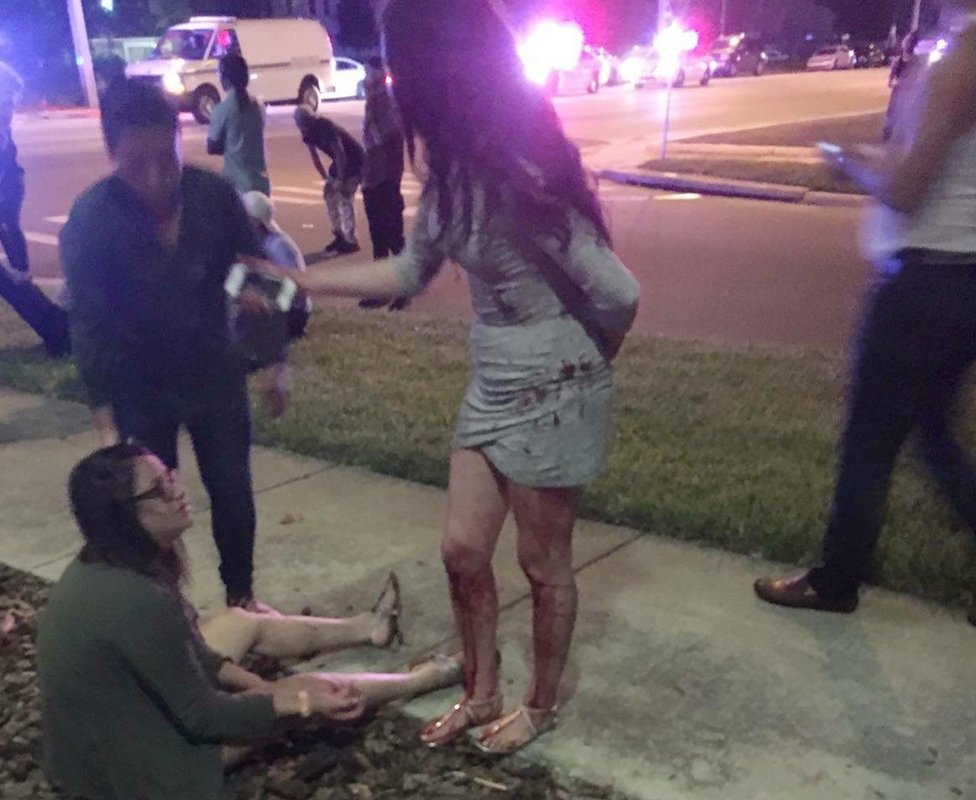 Two girls, covered in blood, outside the club in Orlando, Florida, on 12 June 2016