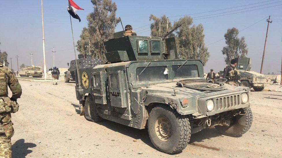 damaged Humvee