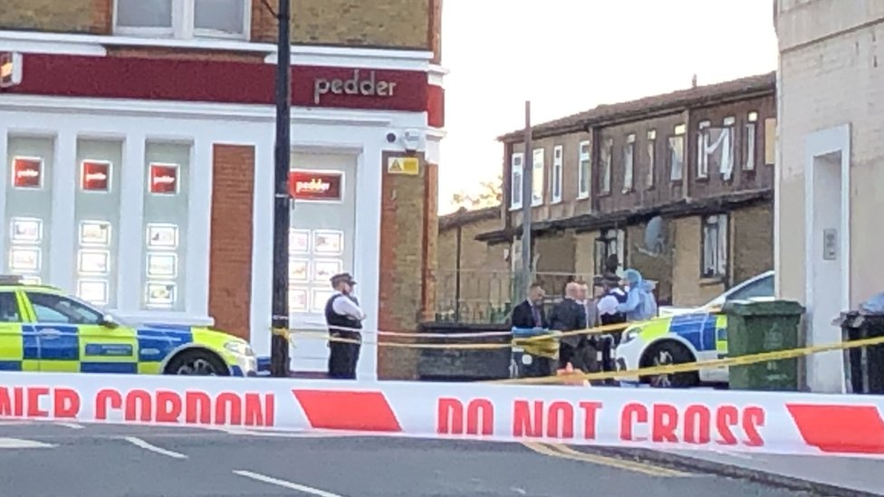 A police cordon in Sydenham Road, south-east London, after a man in his twenties was found with gunshot wounds and died at the scene on Sunday afternoon.