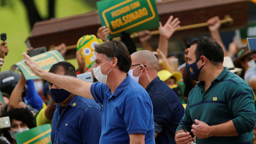 President of Brazil at rally with supporter