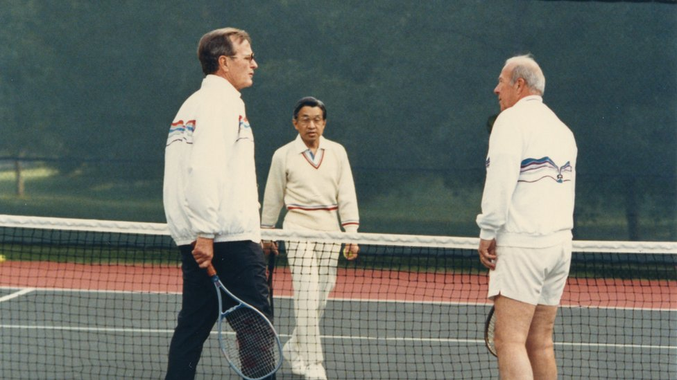 Crown Prince Akihito (C) plays tennis with US Vice President George H.W. Bush (L) and Secretary of States George Shultz (R